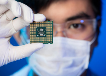 engineer holding a computer microchip